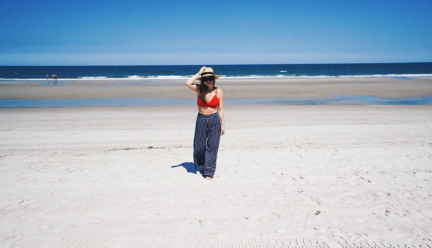 Just Like Gillian in a MissGuided Red Scallop Triangle Bikini Top, a Lack of Color The Spencer Fedora, a pair of Rag and Bone Poet Leggings, and a pair of Karen Walker x Monumental Pablo 50mm Sunglasses.